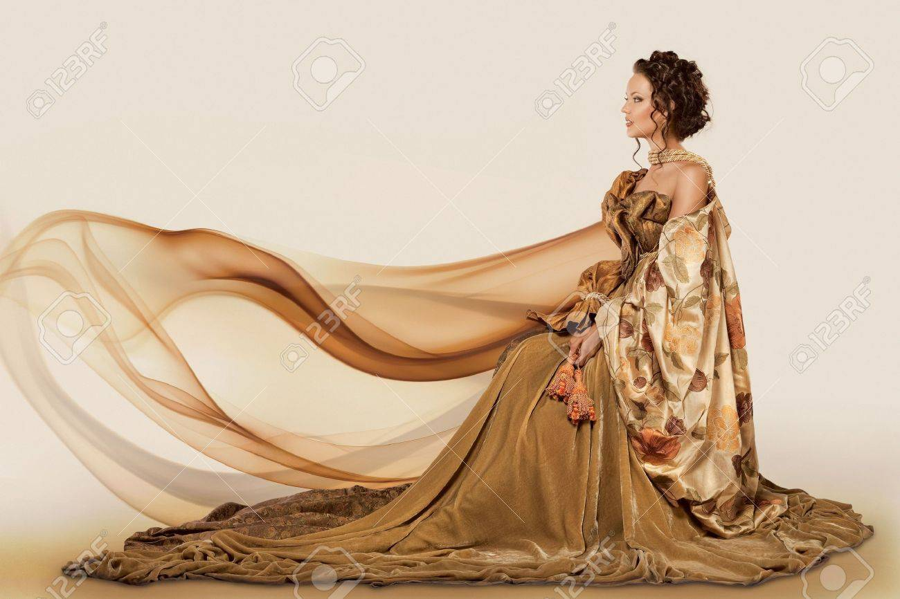 Woman Sitting In A Formal Full Flowing Gown Stock Photo, Picture ...