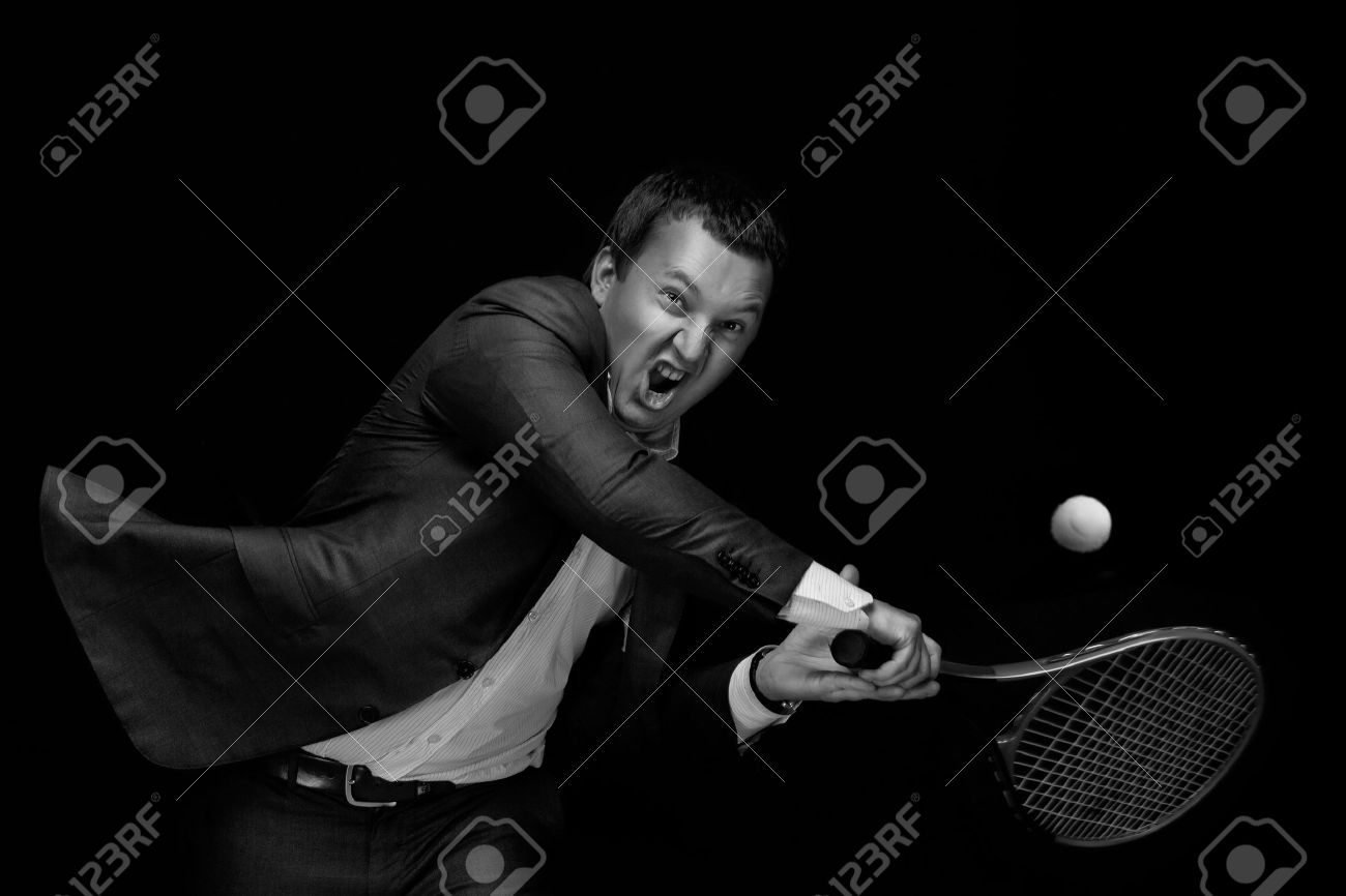 A Portrait Of A Tanned Businessman Tennis Player With A Racket