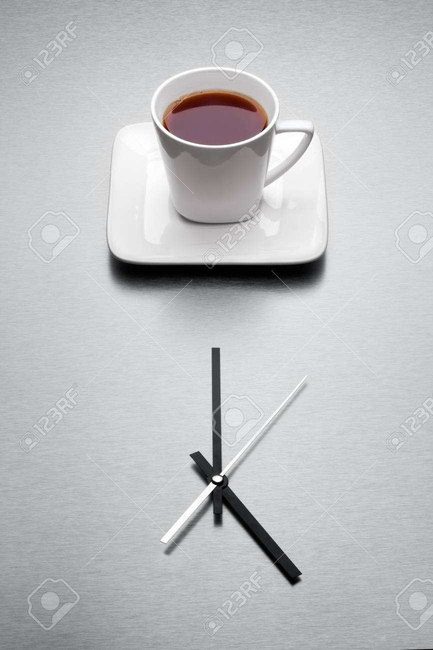 When the day is done the very teatime come - A white mug filled with tea over minimalistic clock Stock Photo - 18666514