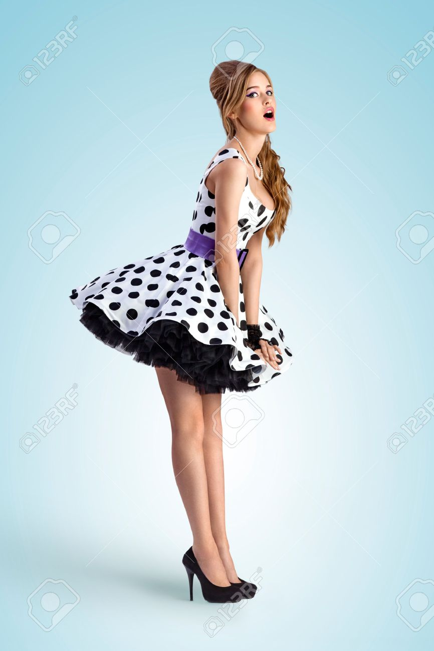 A Vintage Photo Of A Shy Pin-up Girl Wearing A Retro Polka-dot ... a3b3c1a13765