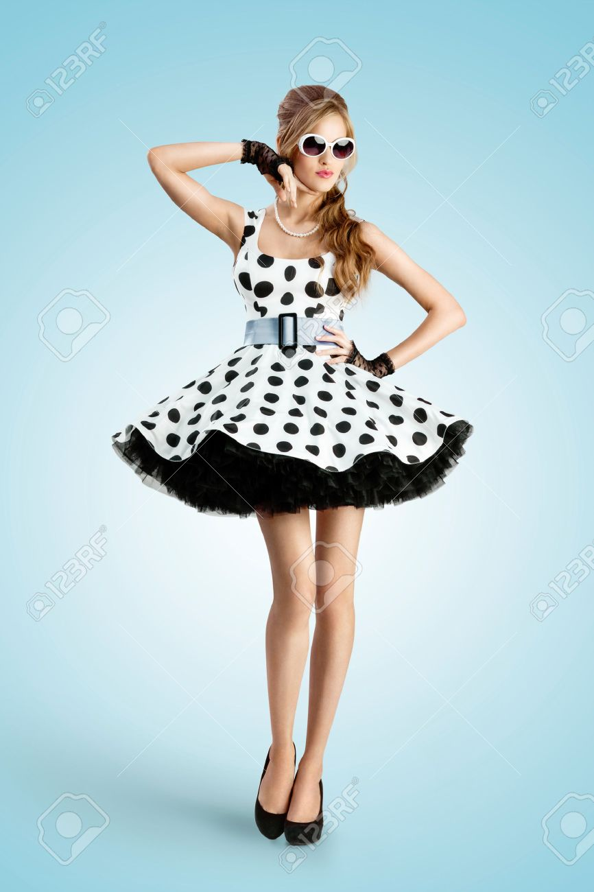 A Vintage Photo Of A Beautiful Pin-up Girl Wearing A Retro Polka ...