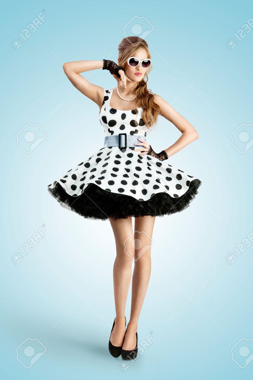359005e5 A vintage photo of a beautiful pin-up girl wearing a retro polka-dot..