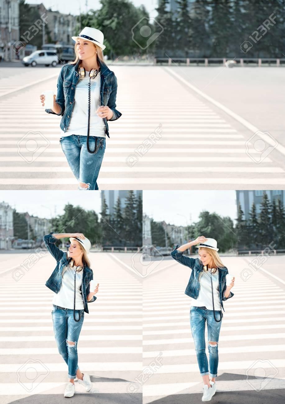 new styles 45680 bfaf1 Bella giovane donna in una giacca cappello e jeans con una tazza di caffè  usa e getta, in piedi sulla strada con strisce pedonali, bere il caffè, e  la ...