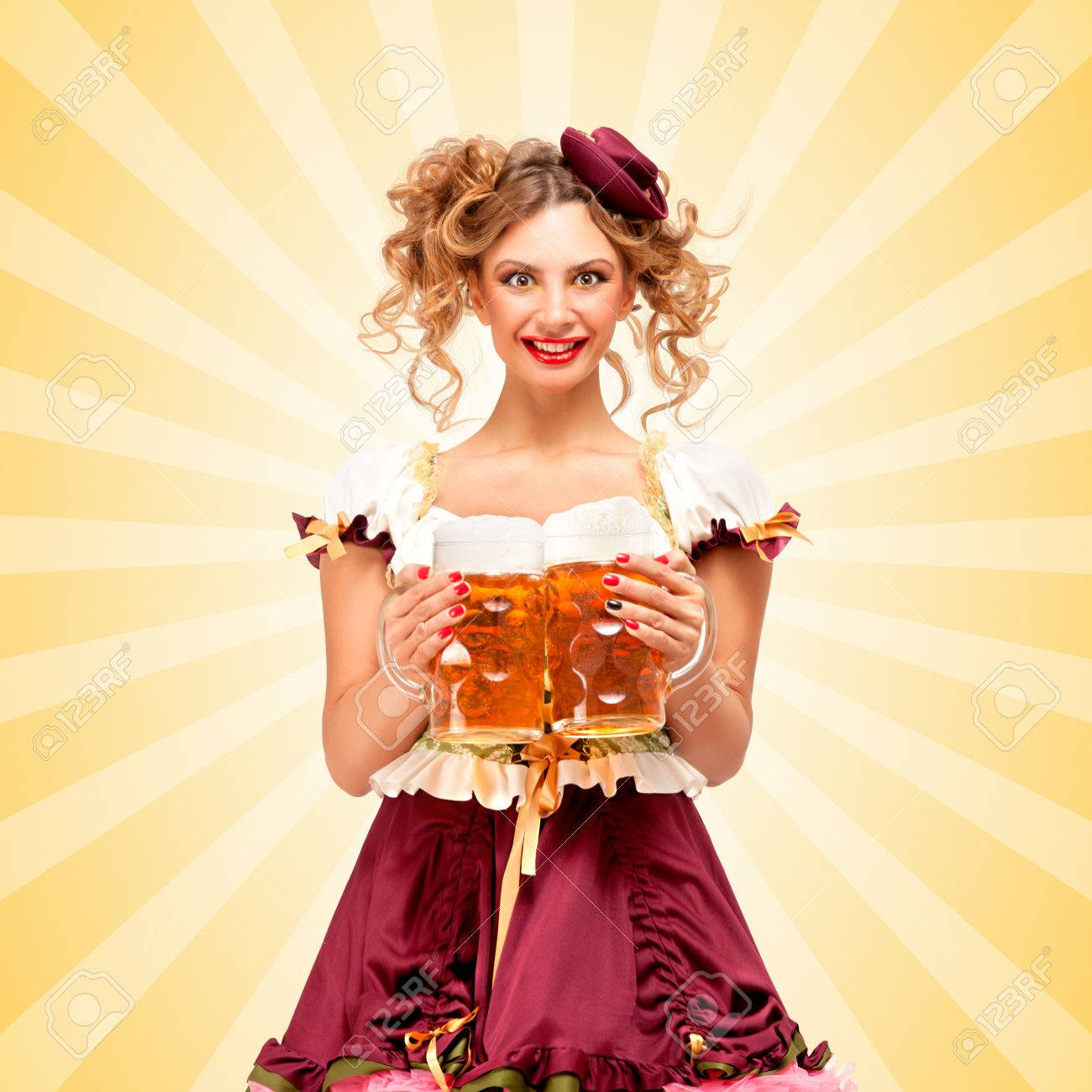Beautiful sexy Oktoberfest waitress wearing a traditional Bavarian dress dirndl serving two big beer  sc 1 st  123RF.com & Beautiful Sexy Oktoberfest Waitress Wearing A Traditional Bavarian ...
