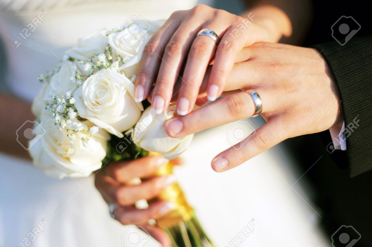 Wedding Rings Bouqet And Hands Holding Stock Photo Picture And