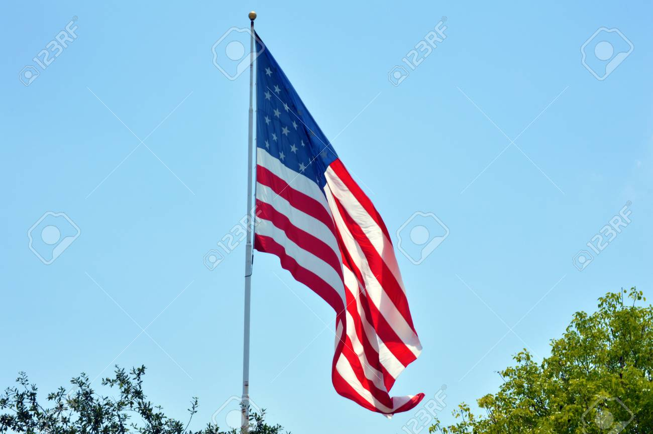 07725c70538 USA flag against vivid blue sky background picture Stock Photo - 37344174
