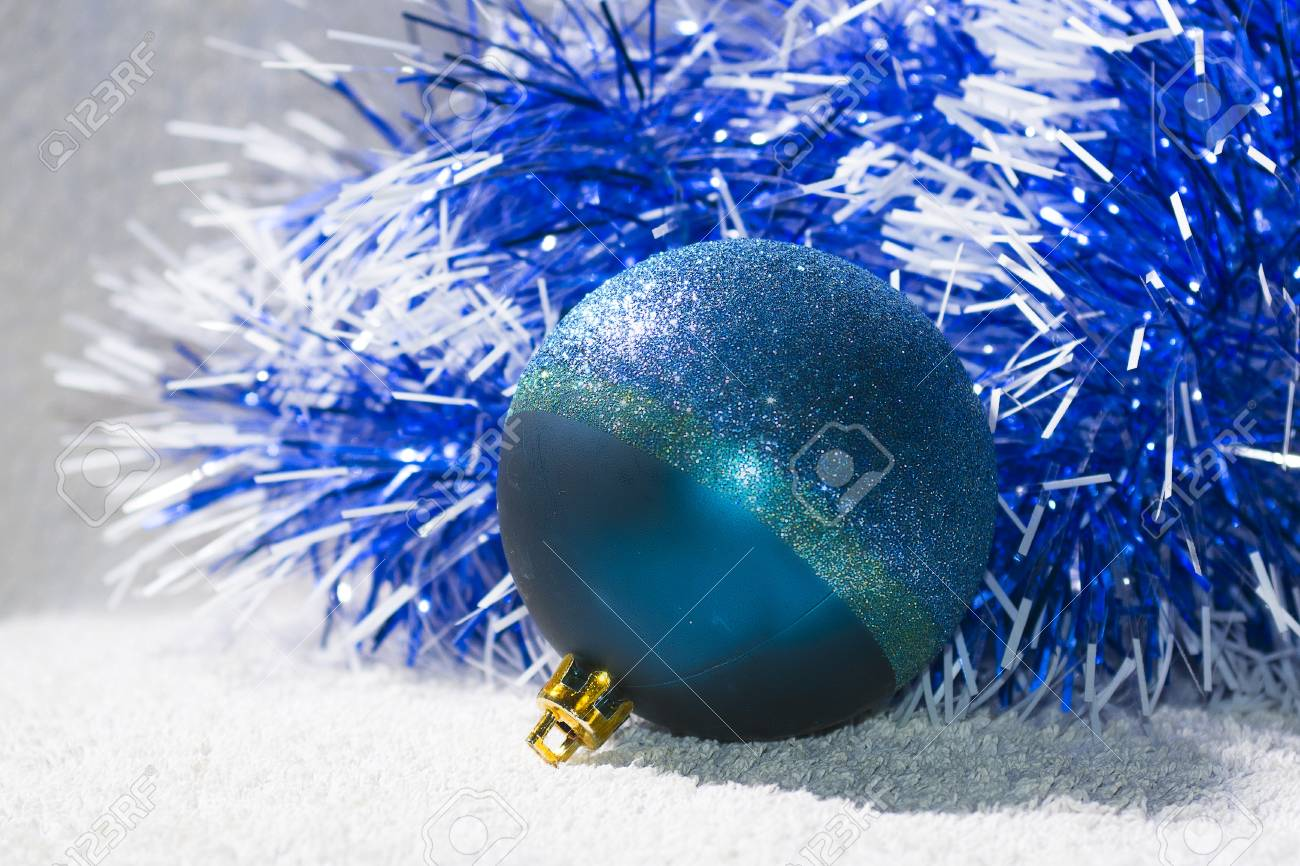 New Years Ball With Blue And White Tinsel Backround Christmas
