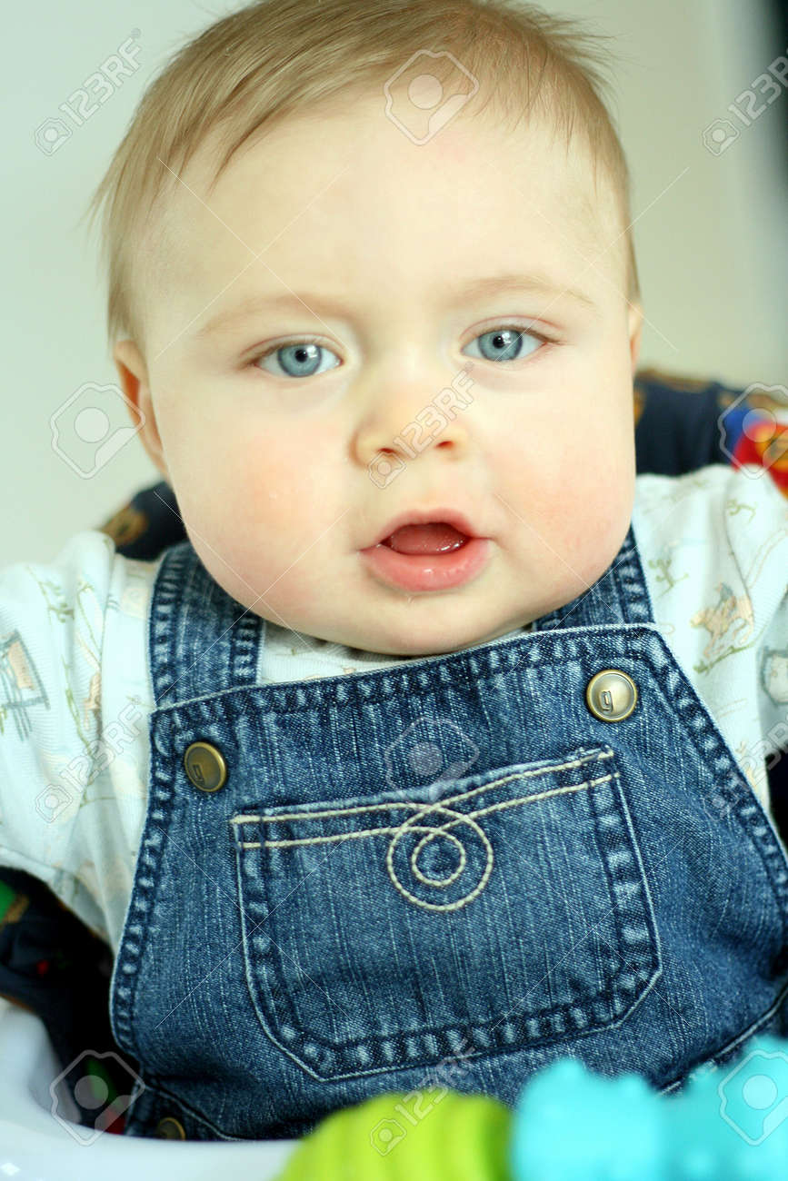 sweet baby boy with blue eyes stock photo, picture and royalty free