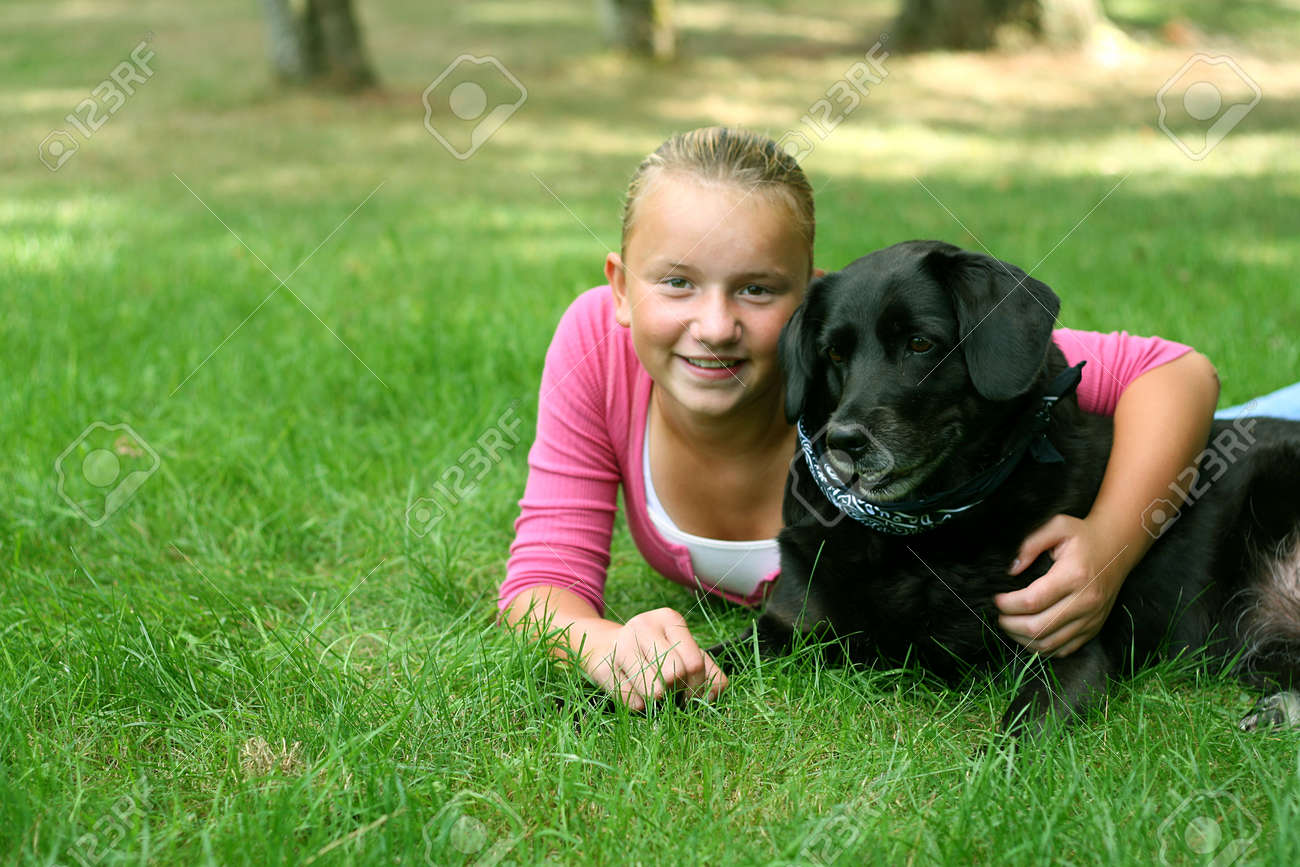 black preteen Preteen girl outdoors with black labrador dog Stock Photo - 1565000