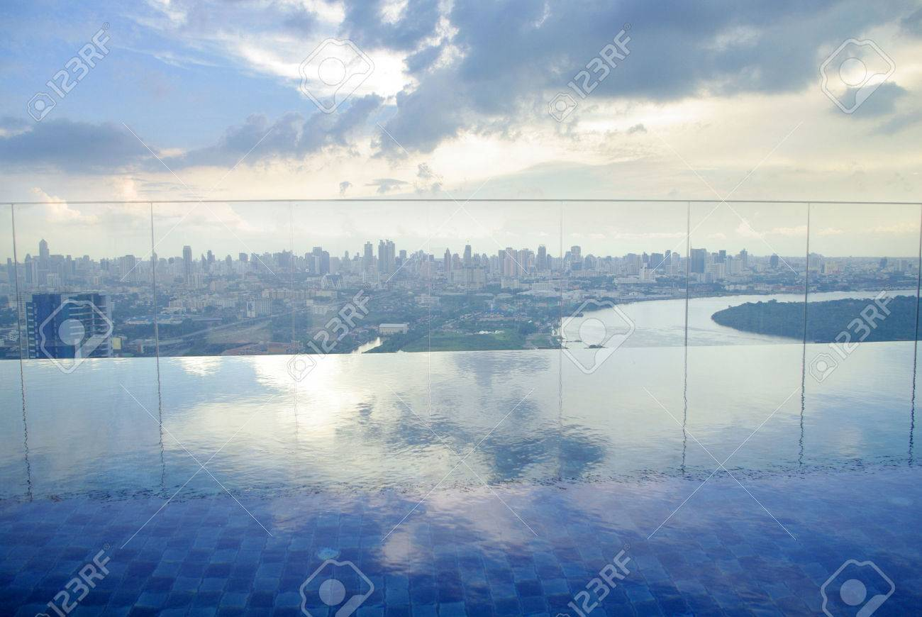 infinity pool on high condominuim building. beautiful view of river and city skyline - 23182387