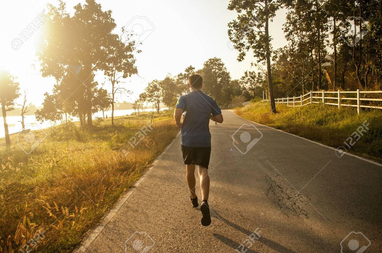 marathon runner running in the morning - 25172832