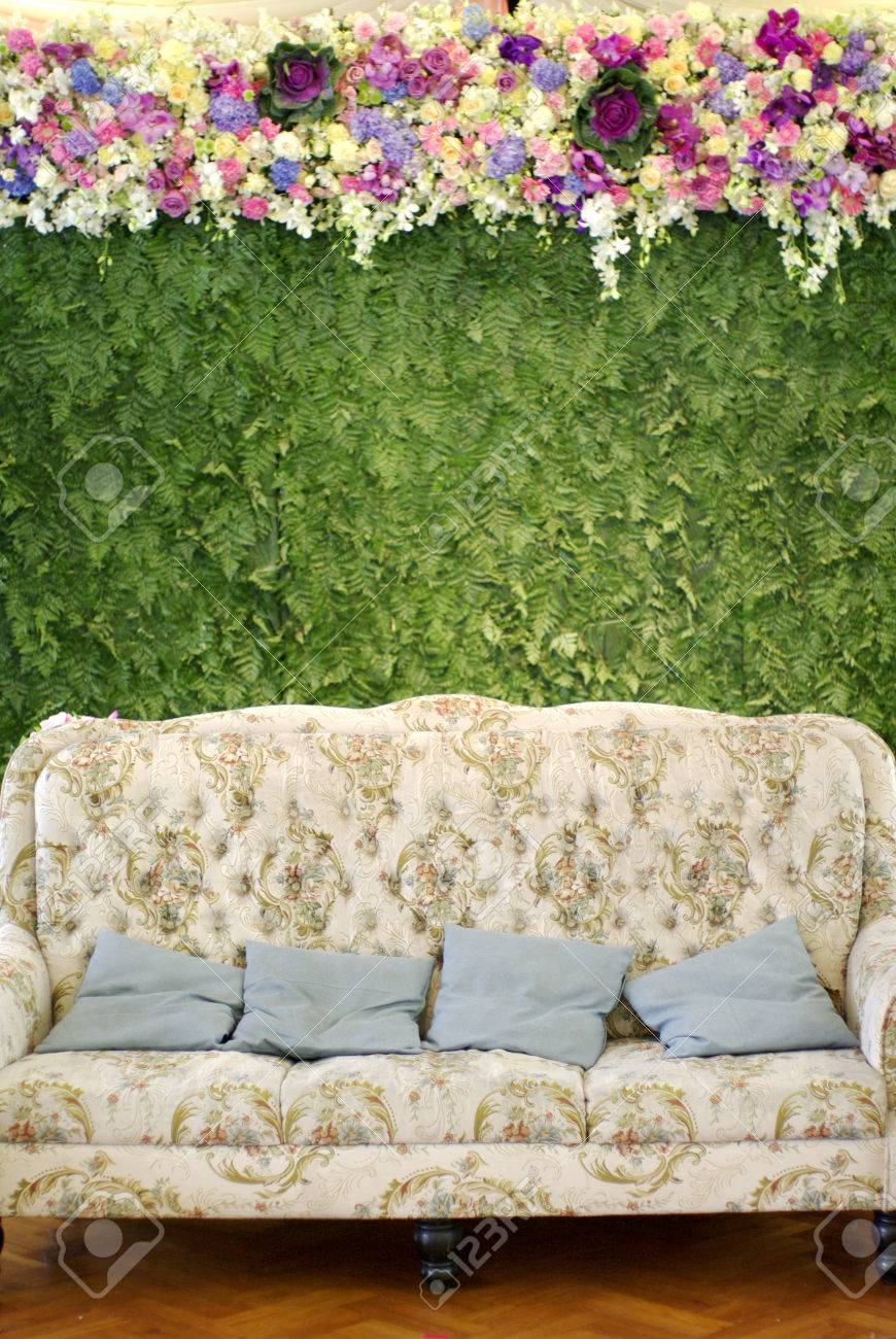 Classic Sofa With Floral Pattern With Flower And Green Setting Stock Photo    26510188