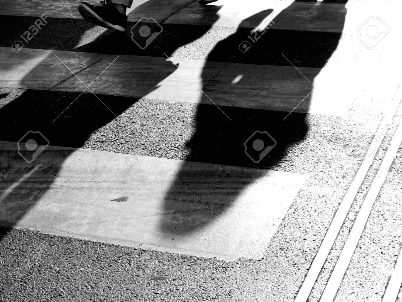 abstract black and white color photo of people walking stock photo