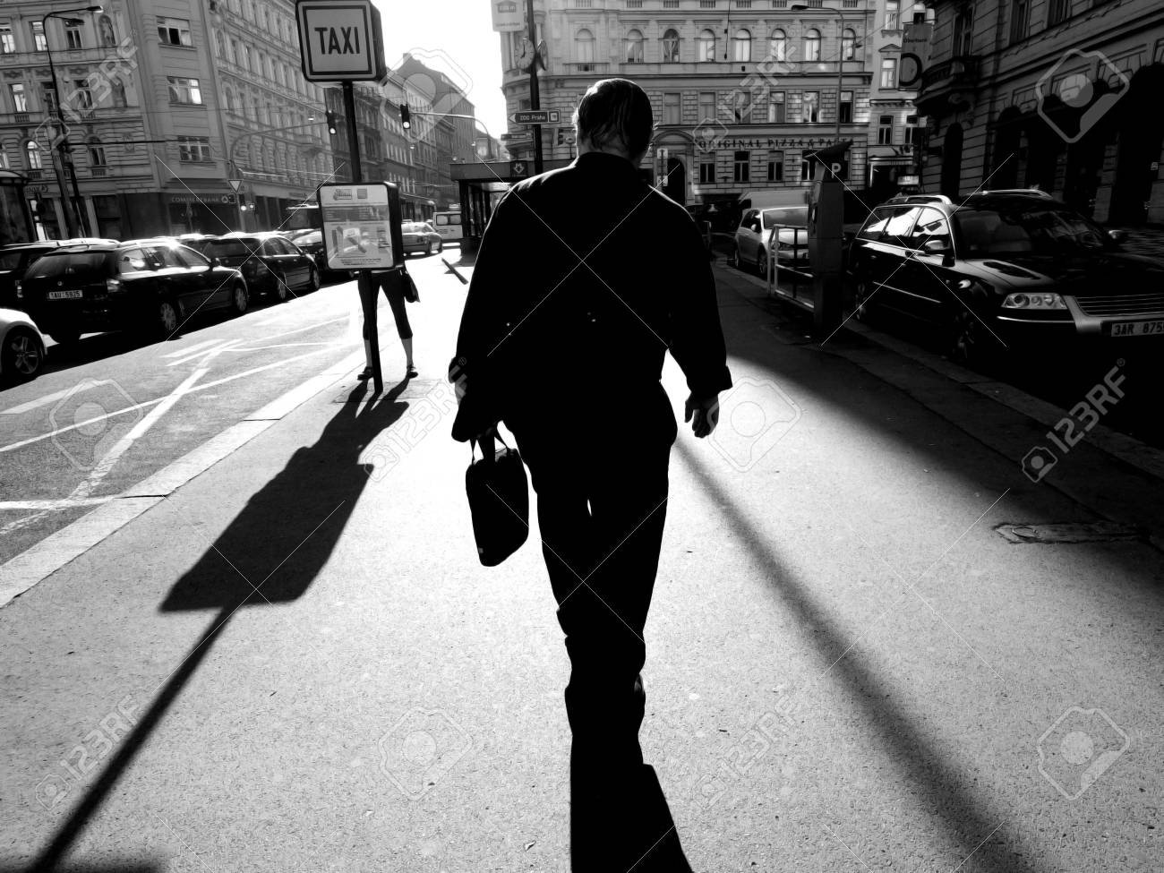 abstract black and white color photo of people walking to work stock