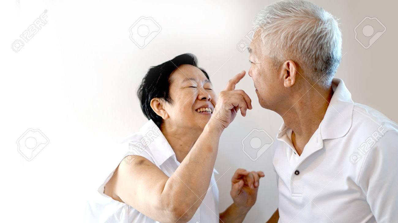 Happy Asian senior couple on white background love and hug - 43006516