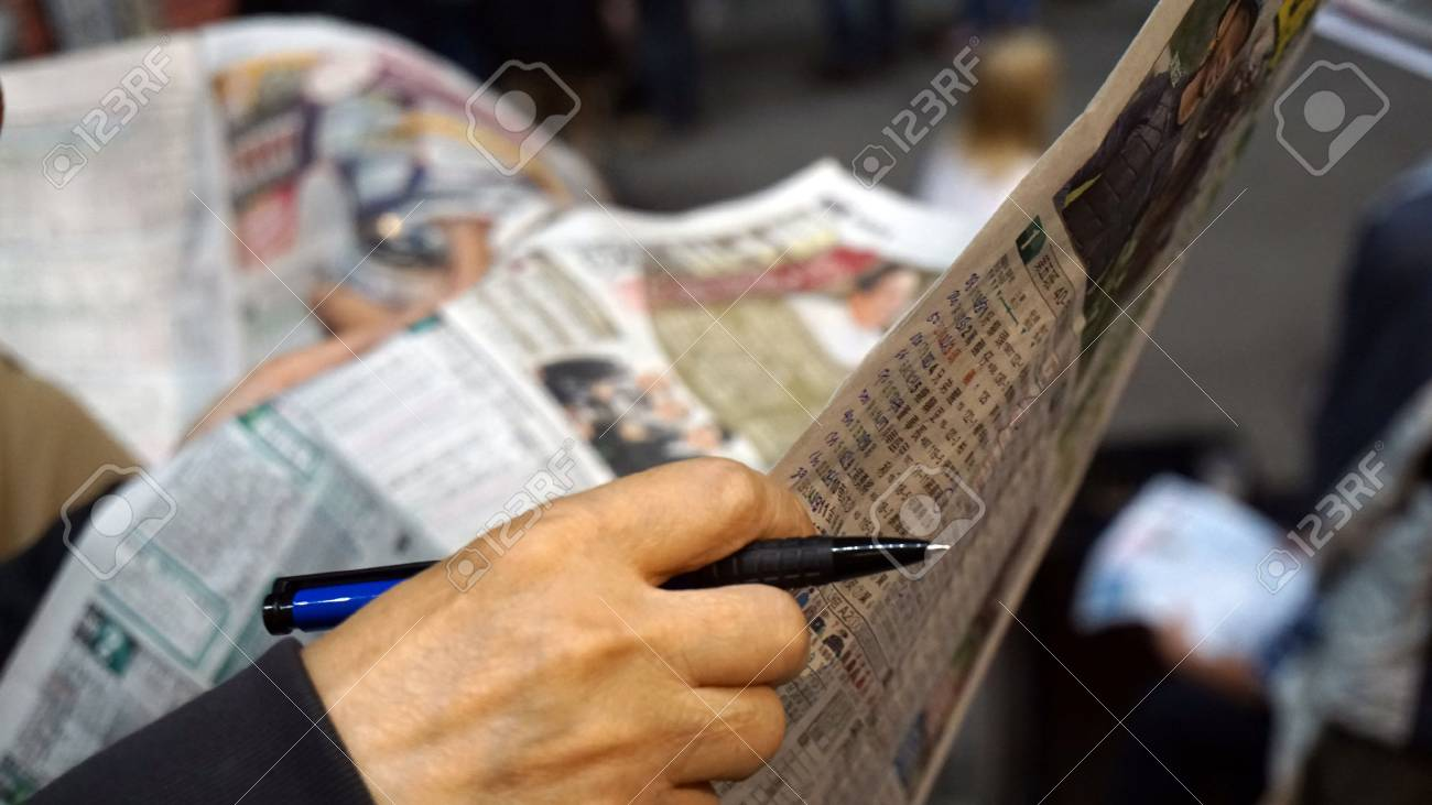 Horse or dog racing gambling hand check points and information from newspaper. Abstract gamble - 63894572