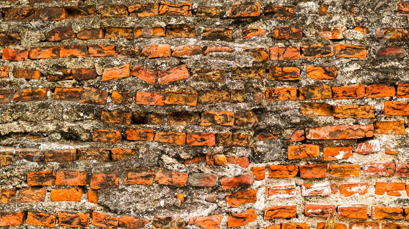Old Rustic Brick And Cracked Plaster Texture Background Stock Photo