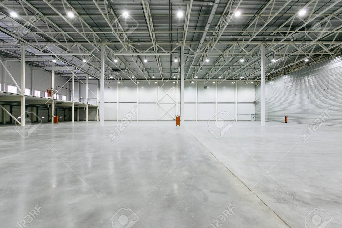 Interior of empty warehouse - 131782760