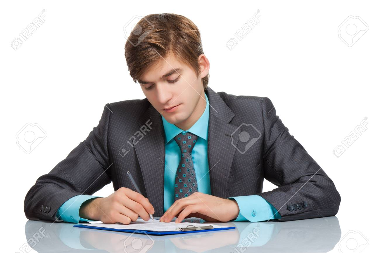 businessman sitting at the desk isolated over white Stock Photo - 13044137