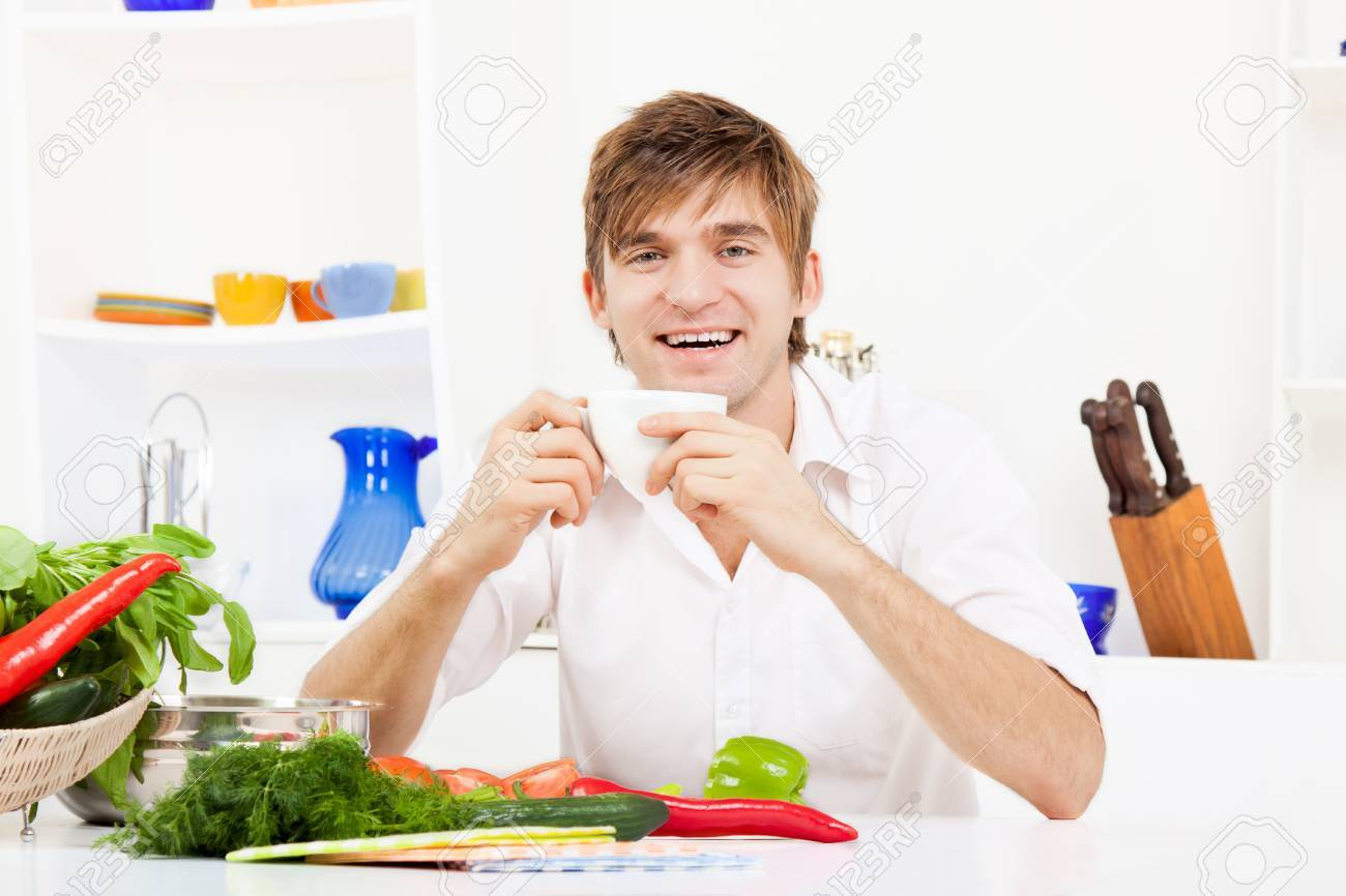 Young Man Cooking On Kitchen Happy Smile Stock Photo, Picture And ...