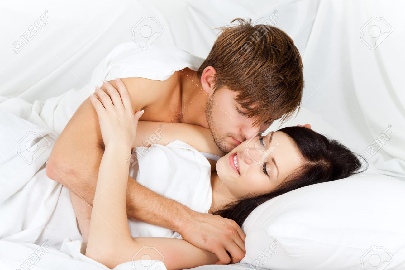 Lovely Couple In Bed Lying In Bedroom Young Lovely Couple Lying In A Bed Happy Smile Stock Photo