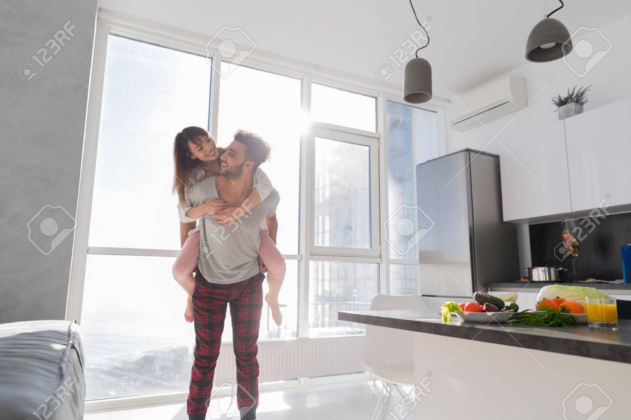 Young Couple In Kitchen, Lovers Hispanic Man Carry Asian Woman ...