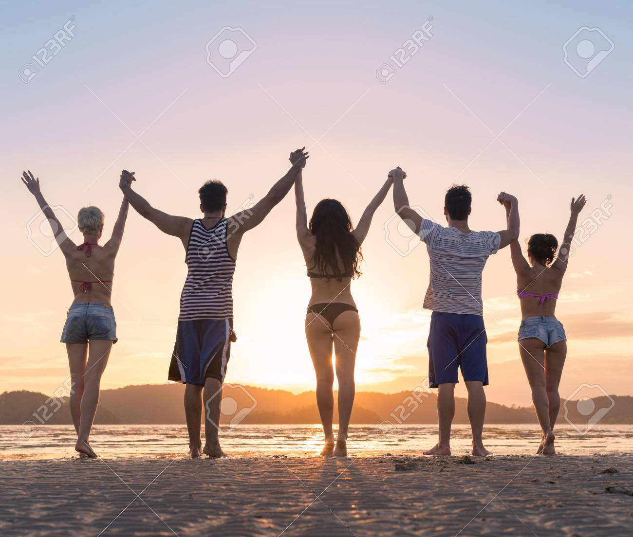 Young People Group On Beach At Sunset Summer Vacation Friends