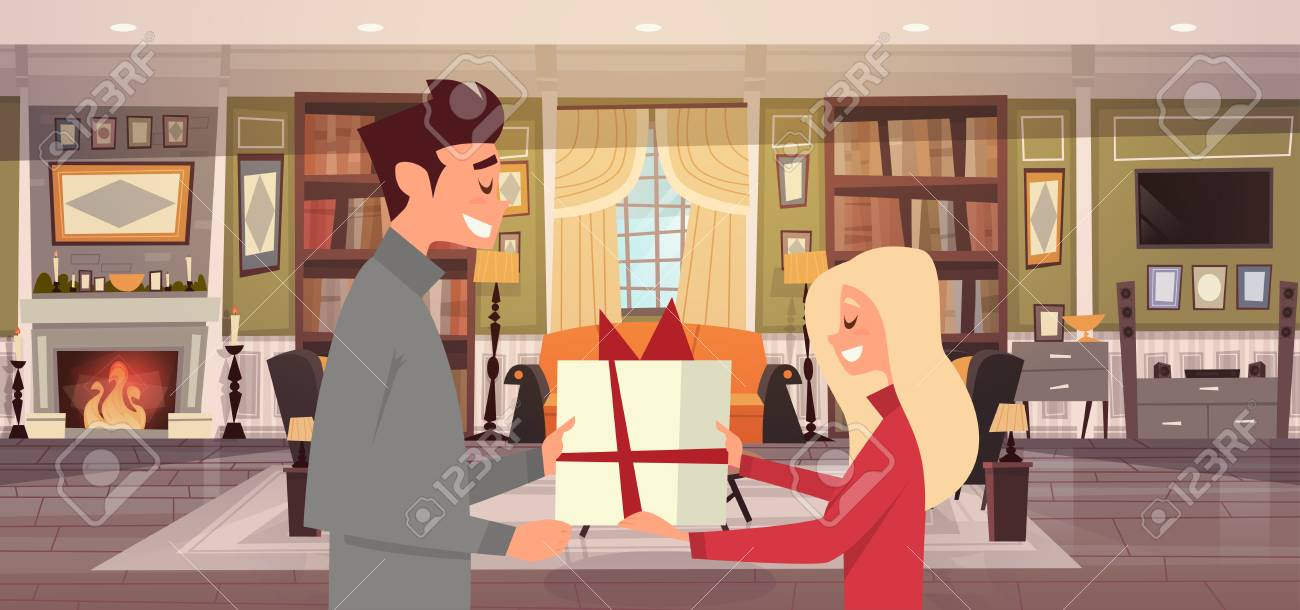 Mann, Der Frau Präsentkarton über Wohnzimmer Hintergrund, Glückliches Paar  Feiert Feiertags