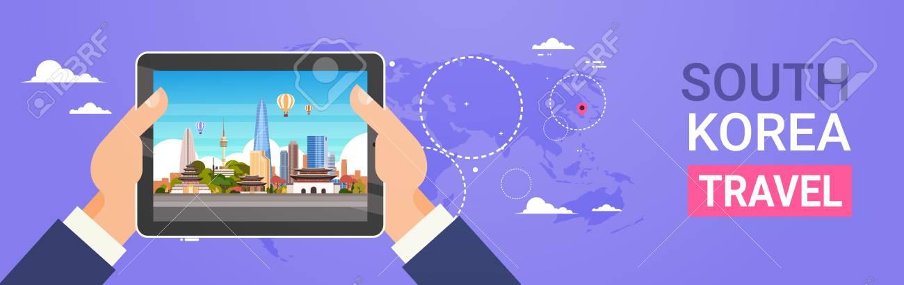 South Korea travel landmarks hands holding digital tablet with