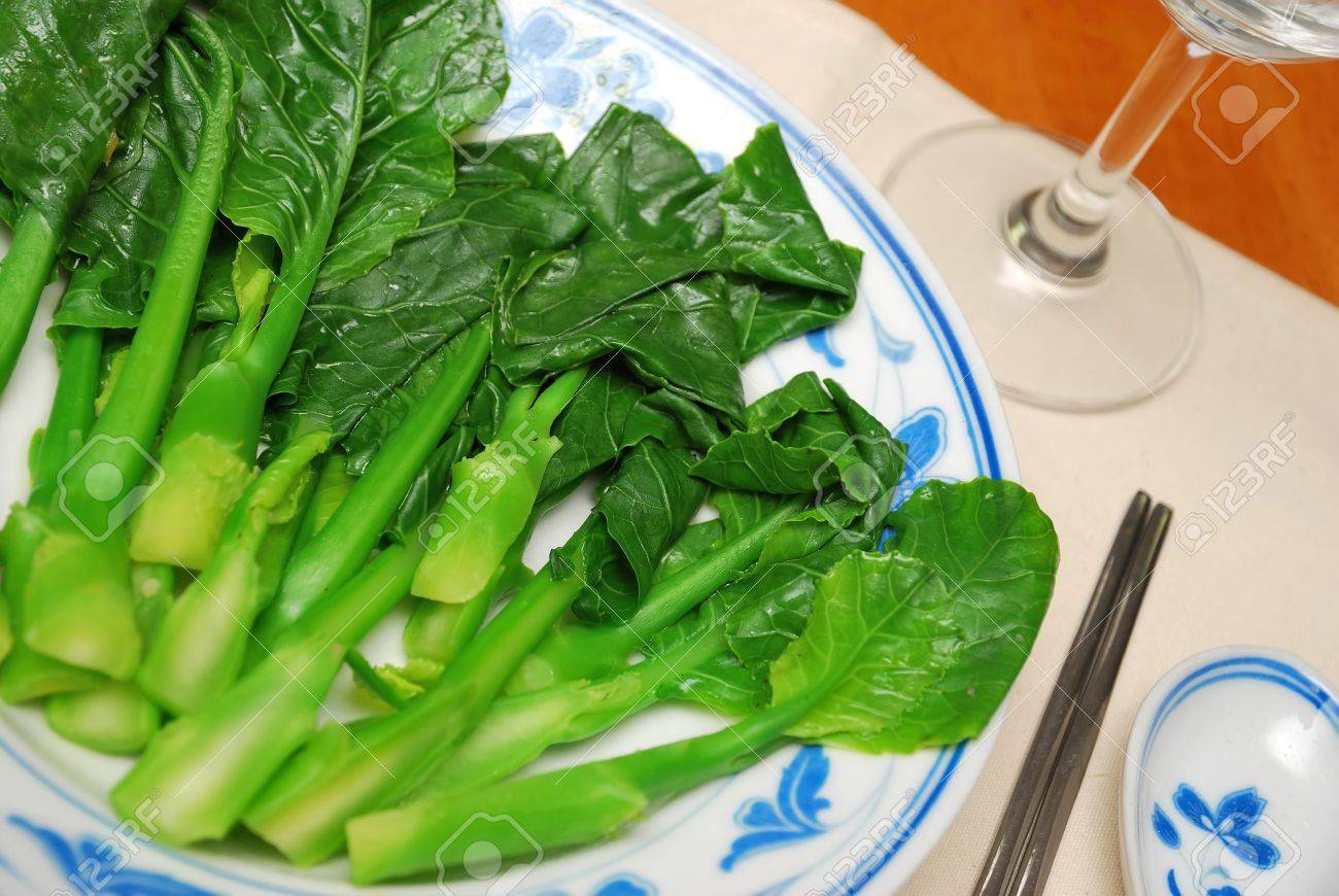 Chinese style stir fried, leafy vegetables. Suitable for food and beverage, healthy eating and diet and nutrition concepts. Stock Photo - 6939882