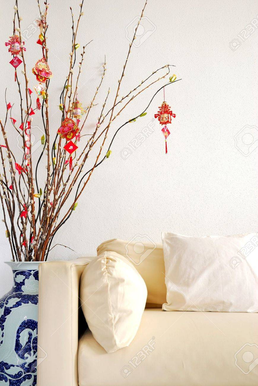 Chinese Lunar New Year decoration with modern sofa. For New Year objects, celebration and festival, and culture and lifestyle concepts. Stock Photo - 7020939