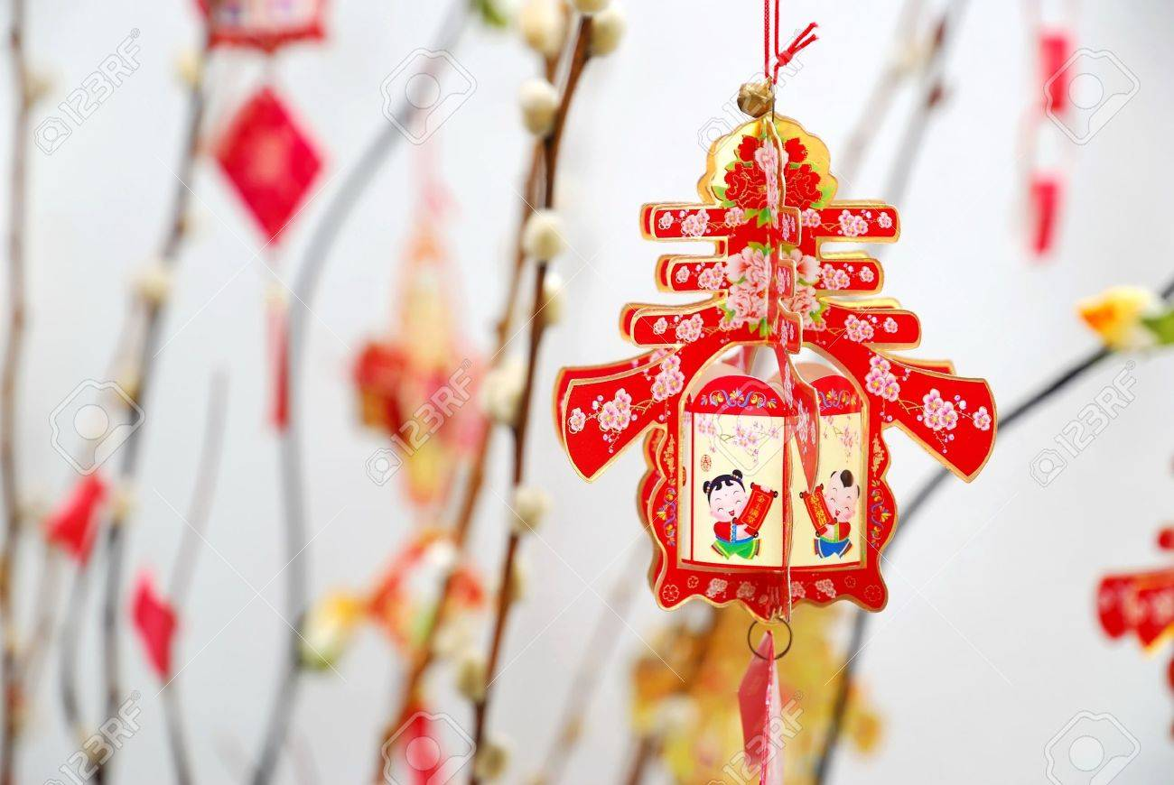 Closeup Of Chinese Lunar New Year Decoration On Tree Signifying The Spring  Season. For New