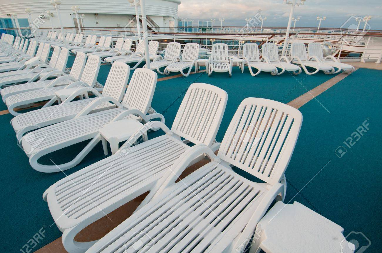 Many Sun Tanning Beach Chairs On Top Deck Of Cruise Ship. Stock Photo    10678125