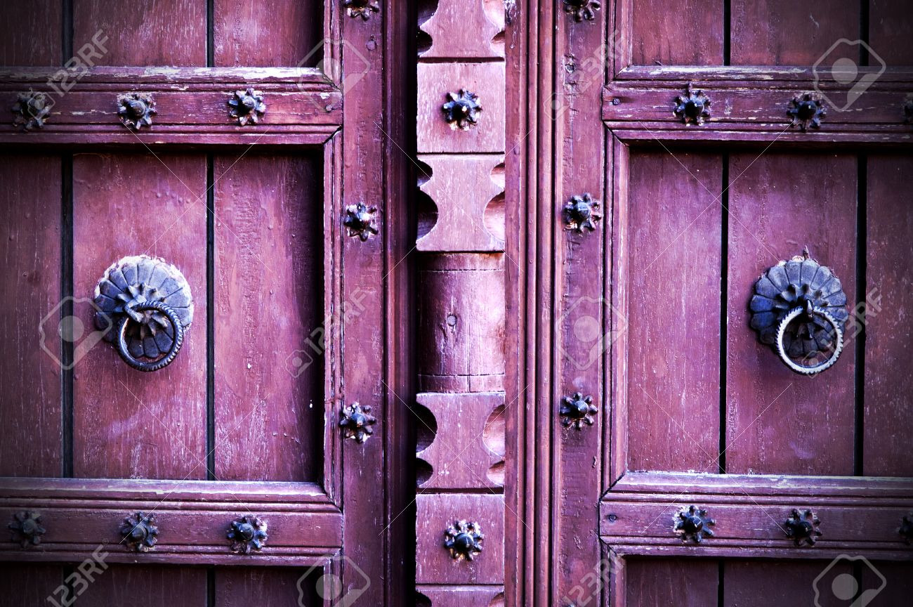 Antique Wooden Doors Painted In Red Colour Decorated With Metal ...