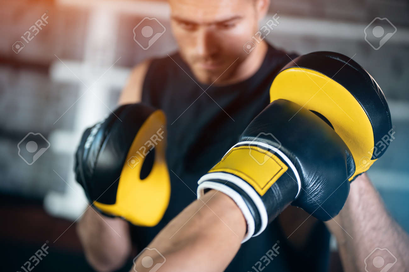 close up of man boxing sparring or fighting in boxing gloves at ring - 159371888