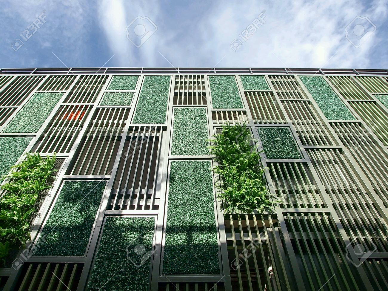 Facade with green wall and blind in geometric pattern Stock Photo - 41470002