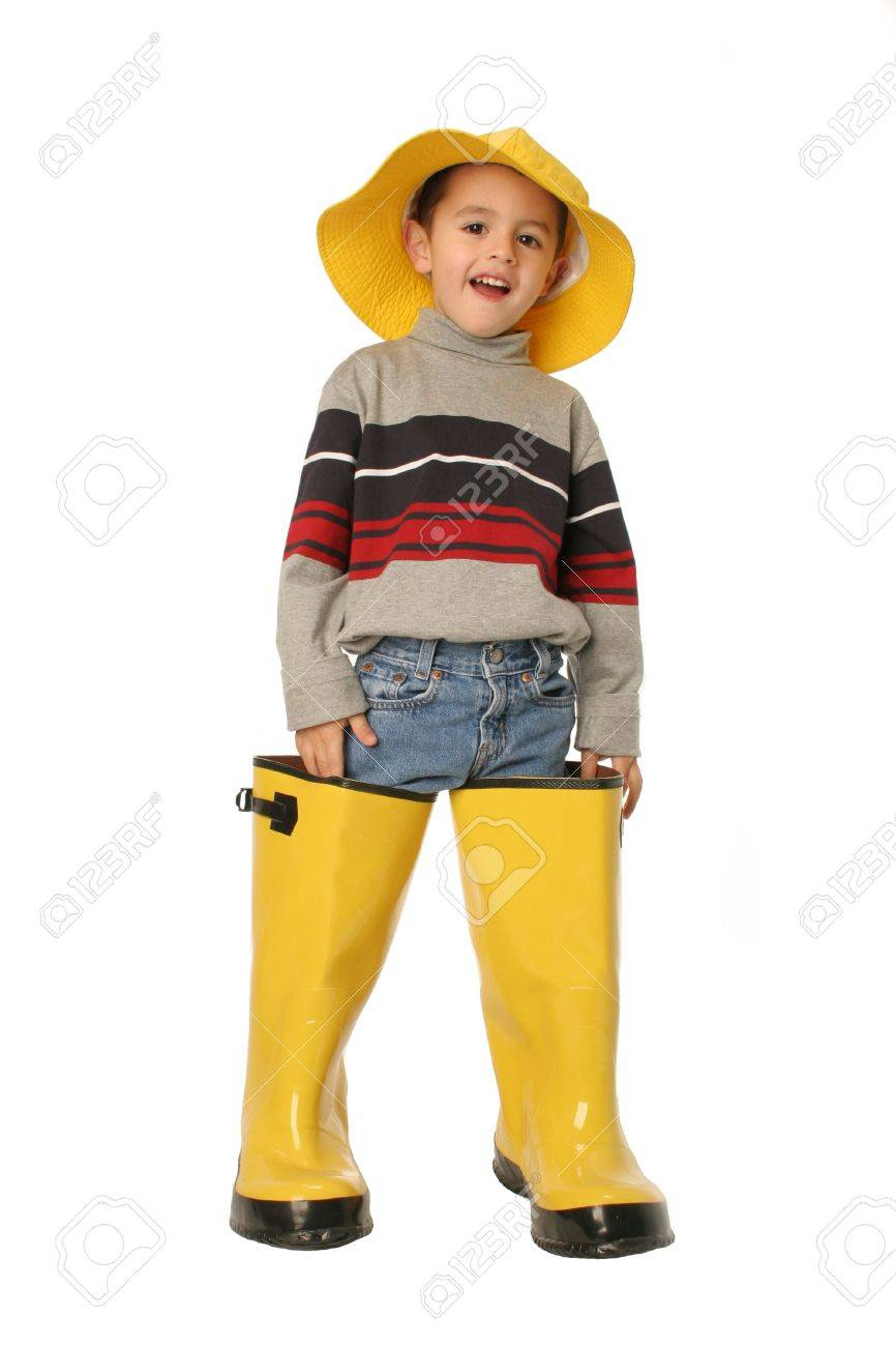 Stock Photo - Wading in Dad s shoes this young boy standing in large yellow  rain boots and a yellow rain hat isolated on white 50cfa2aa350