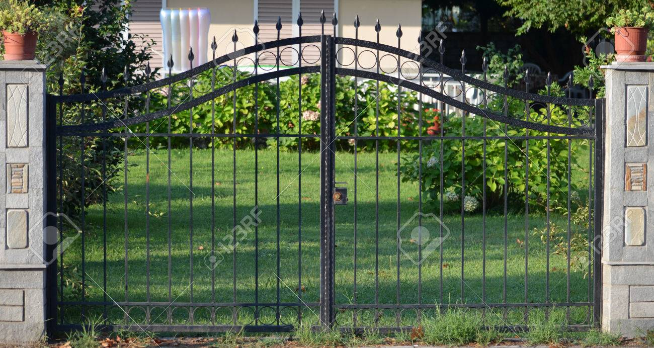 modern metal gate. Modern Metal Gate For The Private House Stock Photo - 30808178 0
