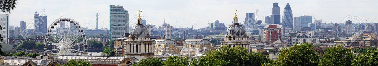 London skyline from Greenwich, with the twin domes of the Old Royal Naval College and the Greenwich Wheel in the foreground.  In the distance are such landmarks as the former Post Office Tower, Tower Bridge, St Paul's Cathedral, Lloyds of London, Tower 42 Stock Photo - 4031282