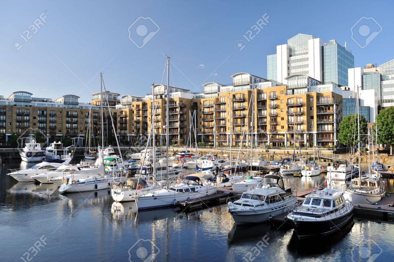 Luxury flats, City Quay, and yachts moored in the east dock marina, St Katherine Dock, London, England, UK, Europe Stock Photo - 5244168