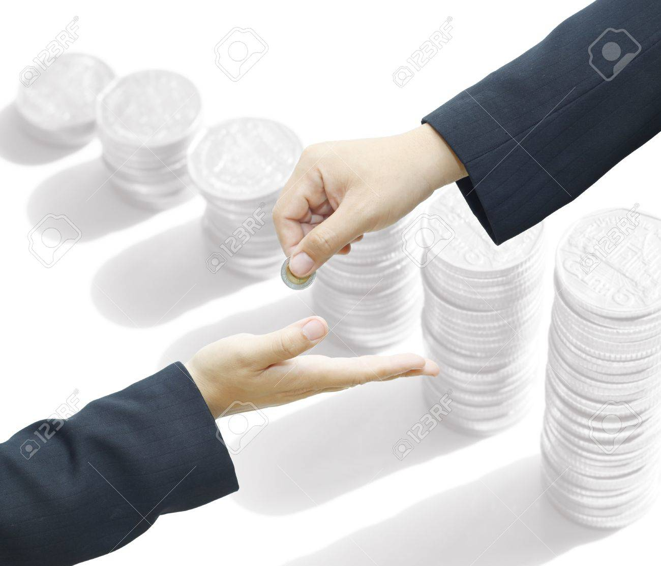 Businessman hand giving a coin for investment to another person on white background Stock Photo - 16509340