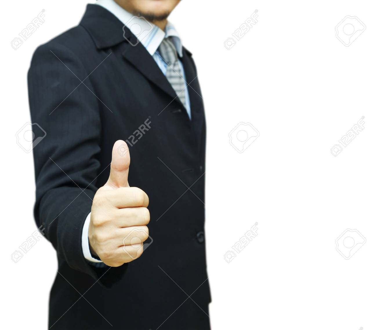 Businessman in suit with thumb up on white background Stock Photo - 16924899