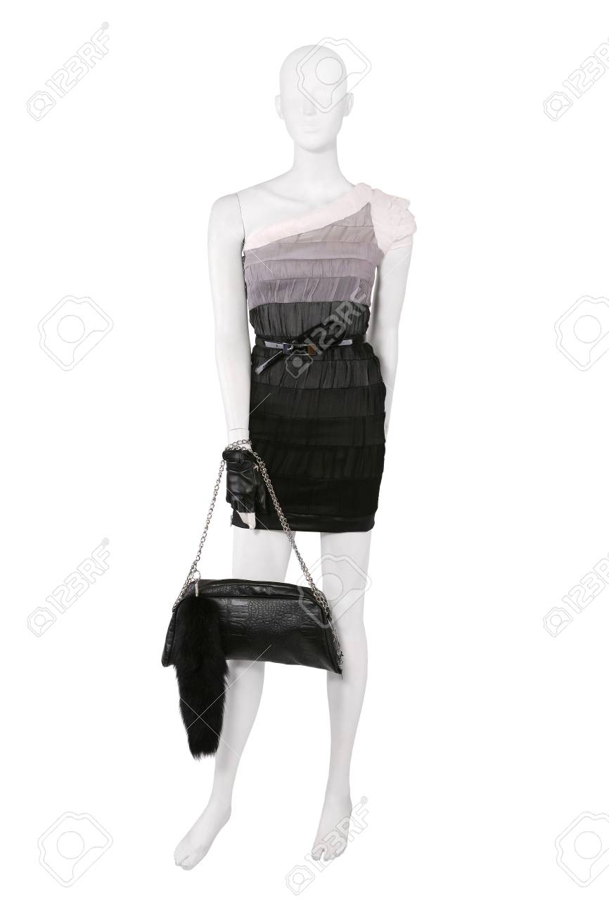 Mannequin dressed in cocktail dress with a bag, isolated on white Stock Photo - 9437636