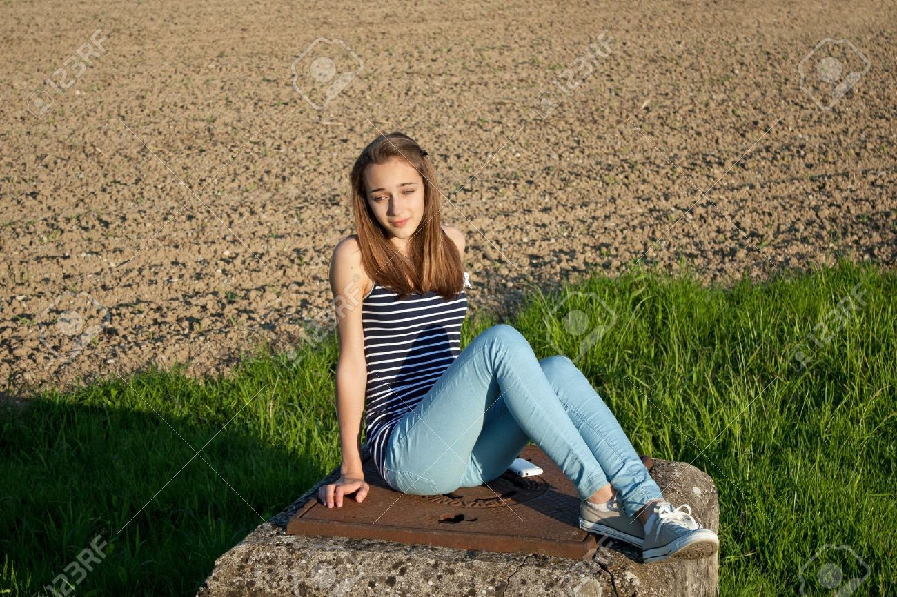 Cute Teens cute teenage girl in the field stock photo, picture and royalty