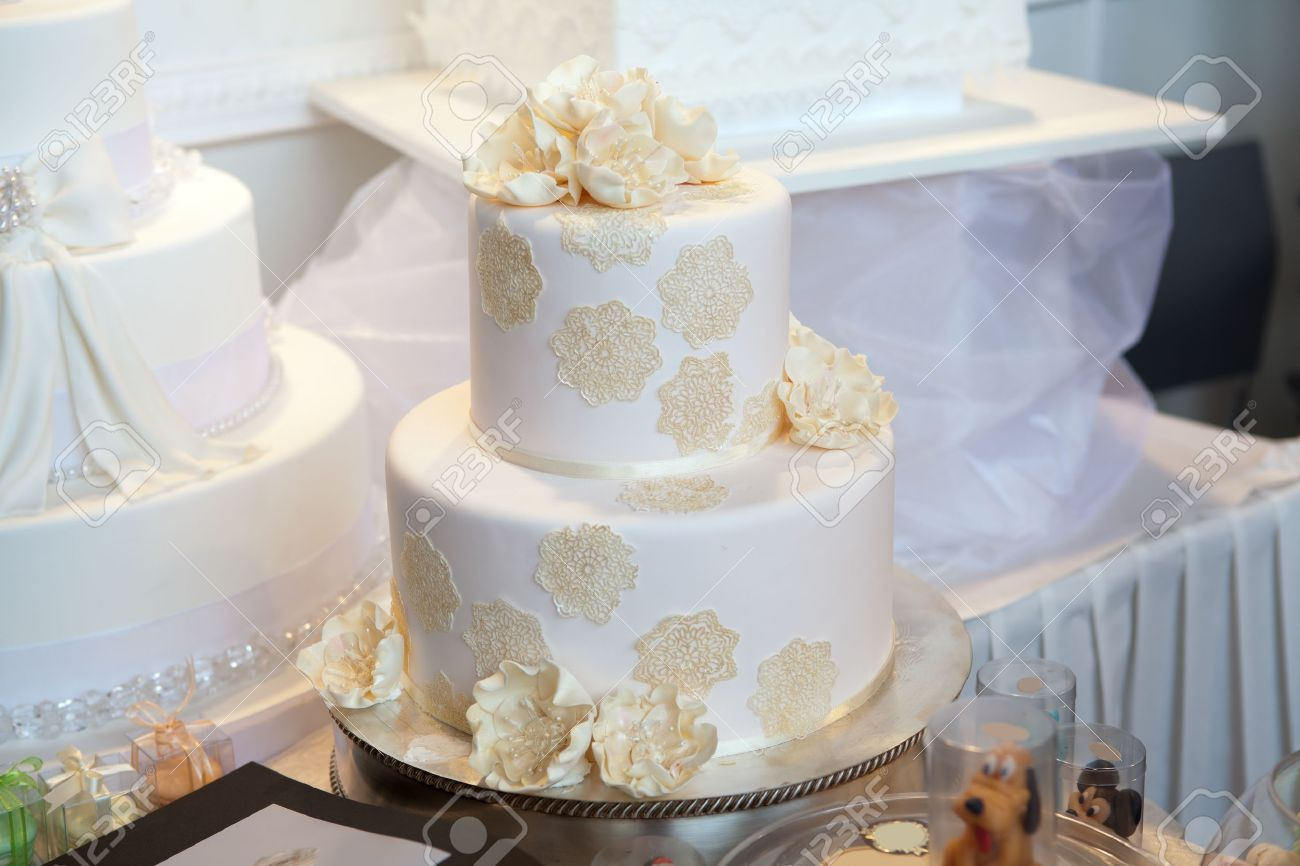 Elegant White Wedding Cake With Beige Flowers Stock Photo, Picture ...