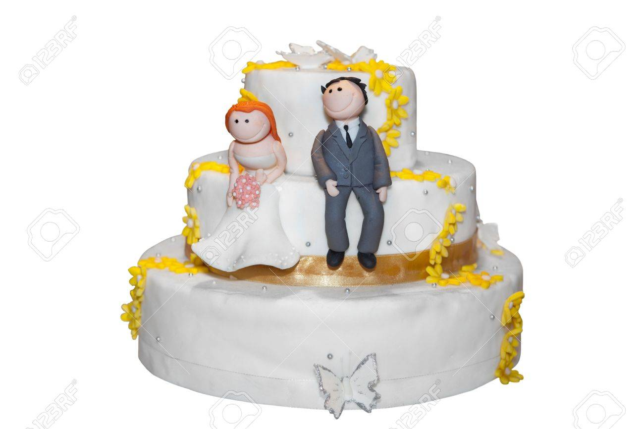 Bride And Groom Figurines On Top Of A Wedding Cake Stock Photo ...