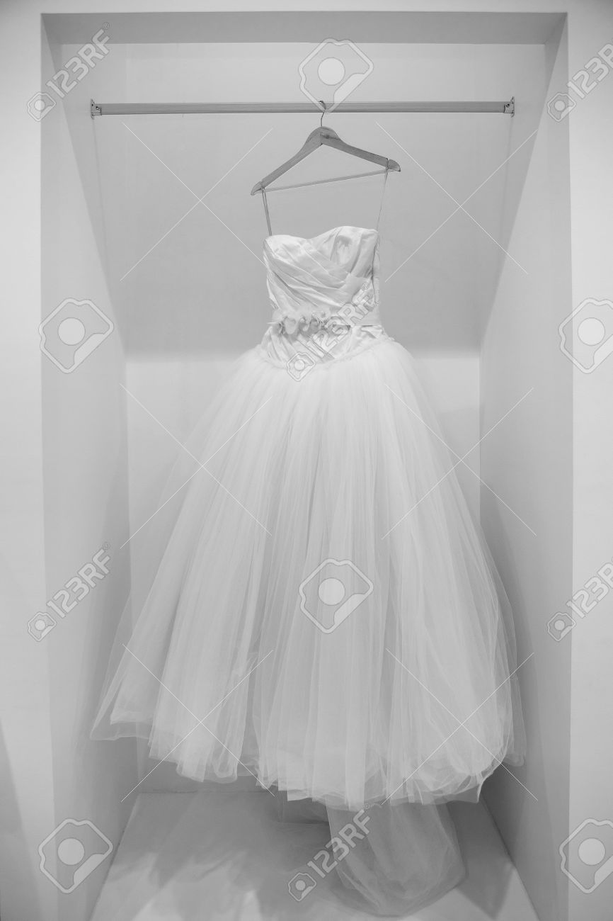 Wedding Dress On A Hanger In Black And White Stock Photo, Picture ...
