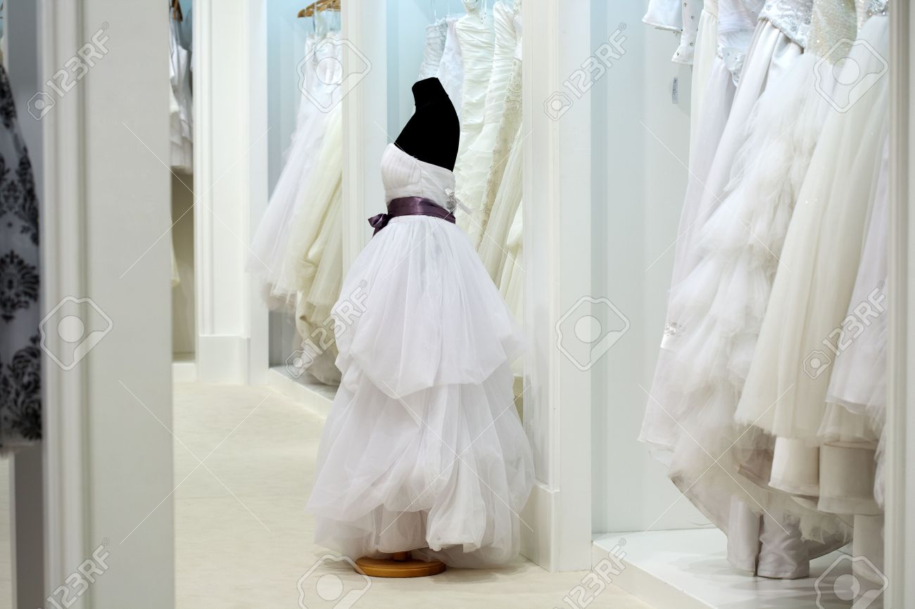 ae9b28eb5 Stock Photo - The range of wedding dresses on hangers and on a mannequin in the  showroom