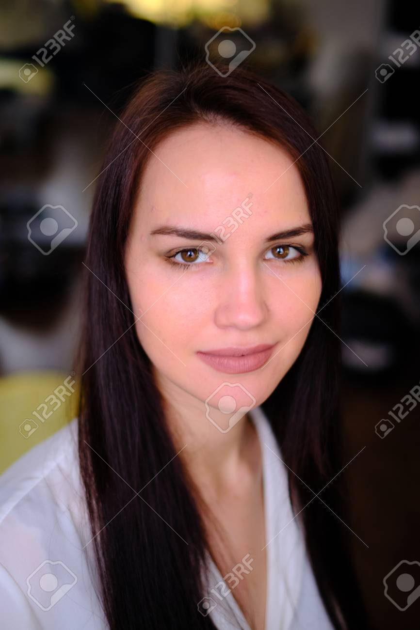 A Young Beautiful Pretty Girl 25 30 Years Old Looks Into The Stock Photo Picture And Royalty Free Image Image 121095030