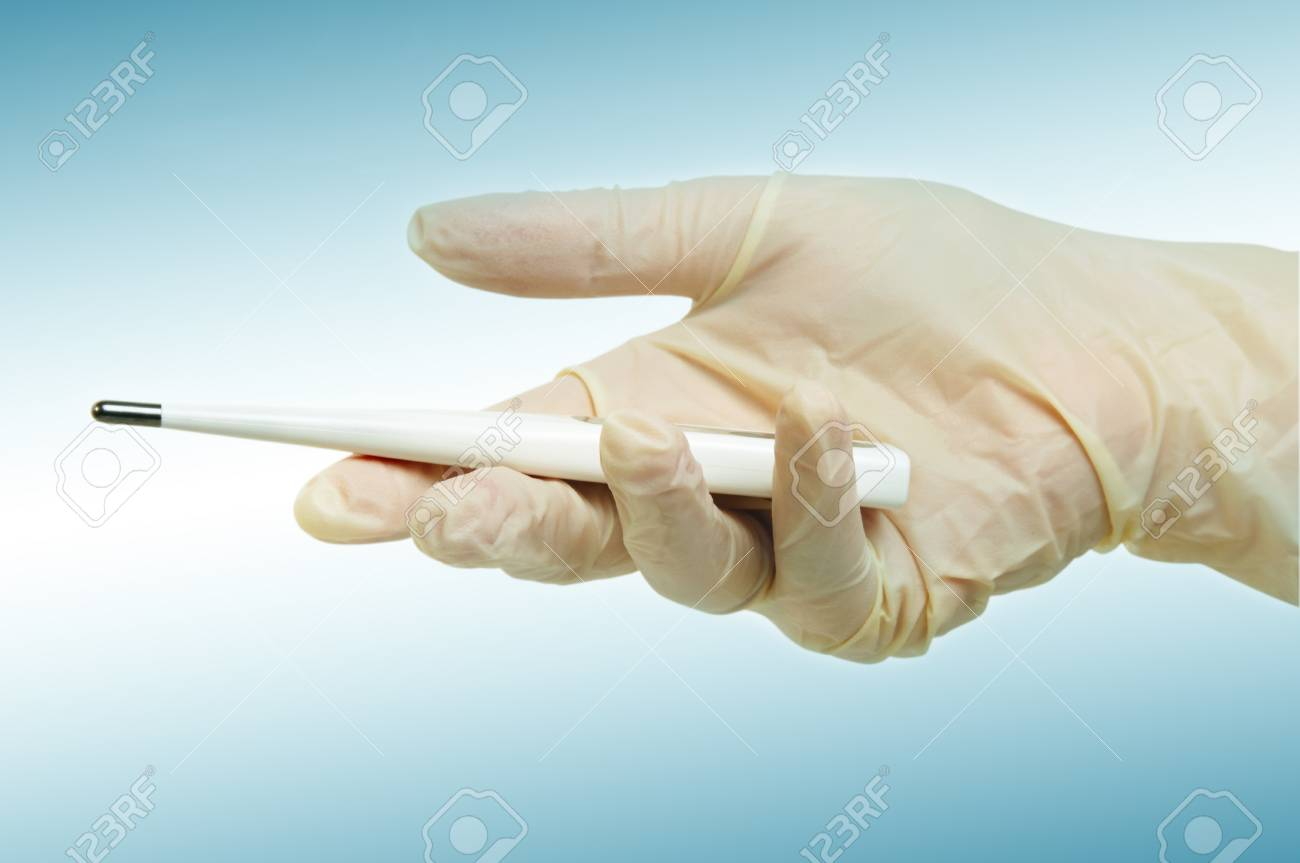 hand with medical gloves and thermometer on light blue surface Stock Photo - 12634943